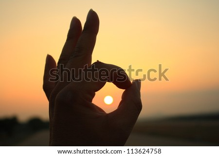 Ok hand sign silhouette.