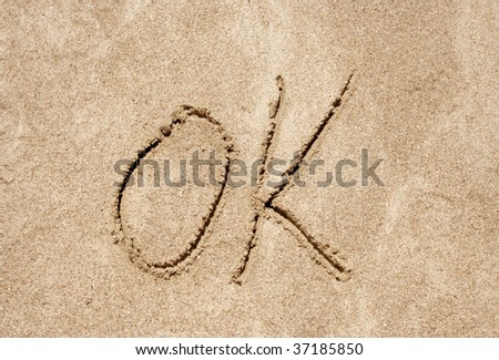 Ok handwritten in sand for natural, symbol,tourism or conceptual designs - stock photo