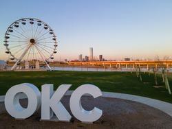 OKC sign and Wheeler Ferris Wheel with skyline