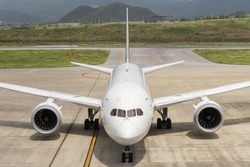 OKINAWA, JAPAN - AUG. 16, 2015: Boeing 787-8 taxing at the New Ishigaki International Airport in Okinawa, Japan.