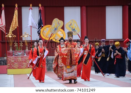 OKINAWA, JAPAN - JANUARY 1: man and woman play King and Queen in the ancient new year ceremony reenacted at Shurijo castle on January 1, 2011 in Okinawa, Japan.