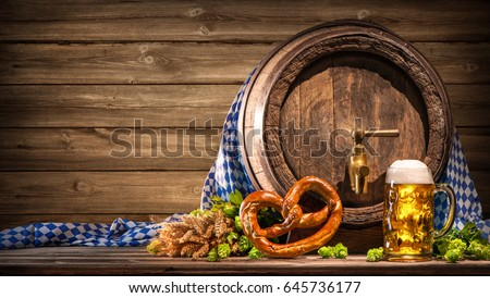 Oktoberfest beer barrel and beer glass with wheat and hops on wooden table Photo stock ©