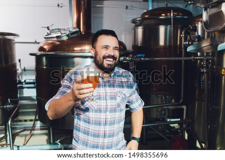 Oktoberfest festival. Tasting fresh brewed beer. Brewer holds glass with craft beer. Brewery concept. Man with beer of mug. Alcohol. Male brewer holds glass with beer. Oktober fest. Barman. Brewer. ストックフォト ©