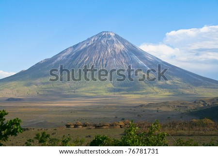 Ol Doinyo Lengai volcano and Maasai village in Tanzania