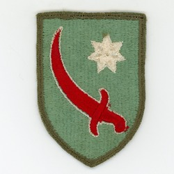 Olathe, KS-10/27/2020: Cloth WWII shoulder sleeve insignia (SSI) of Persian Gulf Service Command (Army unit handling Lend-Lease to USSR and security at Tehran Conference) with red scimitar and star.