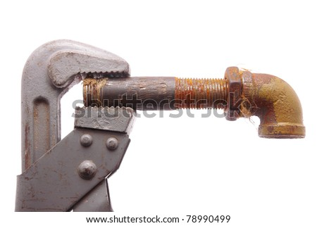 Old a pipe and a wrench on a white background