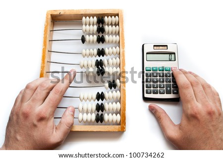 old abacus with calculator and hands
