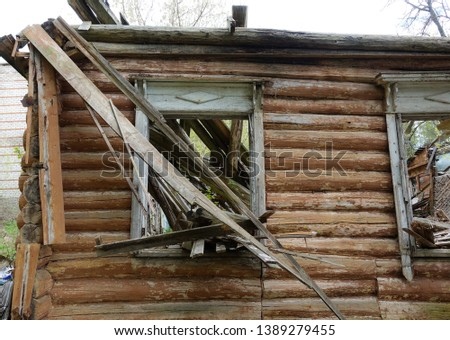 Old abandoned and destroyed log house in Russia. Abandoned house in the middle of the forest stock photo