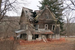 Old abandoned and neglected house. Seasonal.