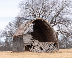 Old abandoned barn that has started to collapse