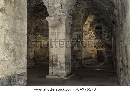 Old abandoned basement in a castle with corridors and labyrinths. #704976178