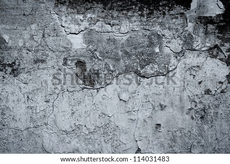 Old abandoned black and white wall