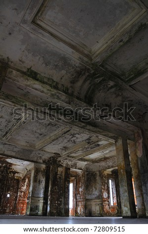old abandoned building interior and ceiling, perspective from the floor (ballroom at Bokor hill station, Cambodia)