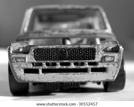 Old abandoned burned car isolated over white