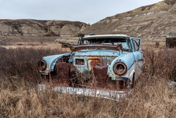 Old abandoned cars in the badlands of Alberta.