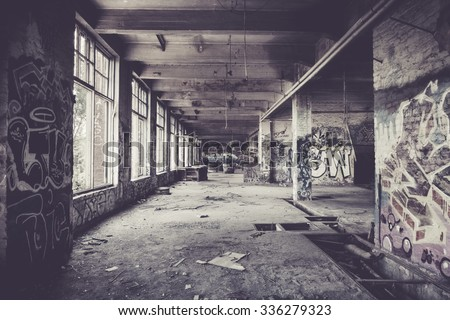Old abandoned factory hall and graffiti