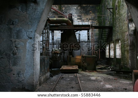 Old abandoned factory with useless rusty machinery