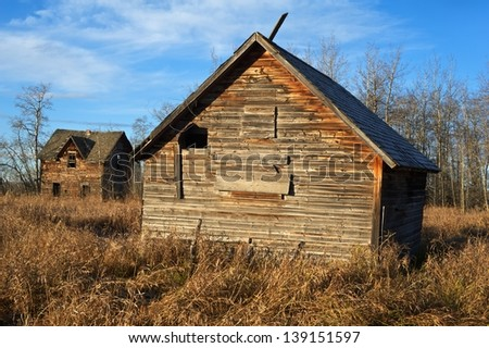 old abandoned farm with house and barn