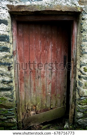 Old abandoned farmhouse with the door left open slightly  #678716773