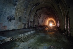 Old abandoned flooded drainage tunnel.