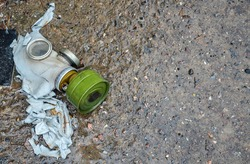 Old abandoned gas mask against radiation lying on the ground and rotting in Pripyat, Chernobyl Exclusion Zone, Ukraine