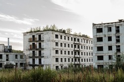Old abandoned high-rise building. Crumbling residential building