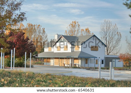 Old abandoned home with autumn trees