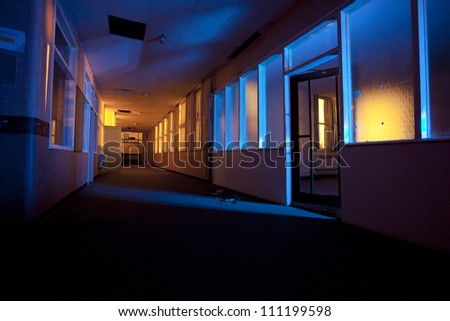old abandoned hospital building internals light painted at night