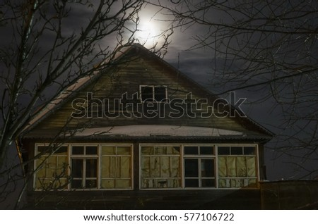 Old abandoned house in the light of the moon #577106722