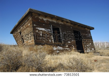 Old abandoned house near collapse in desert