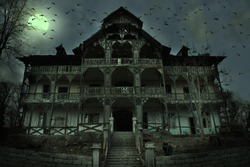 Old abandoned mansion in mystic spooky forest. Ancient haunted house with dark horror atmosphere