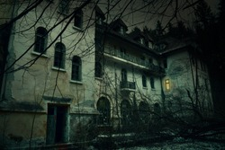 Old abandoned mansion in mystic spooky forest. The ancient haunted house of the crime scene with dark horror atmosphere and creepy details