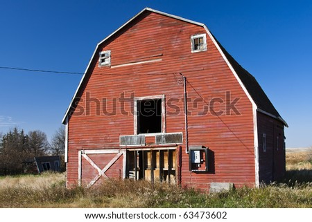 Old abandoned red barn on the prairies of Canada.