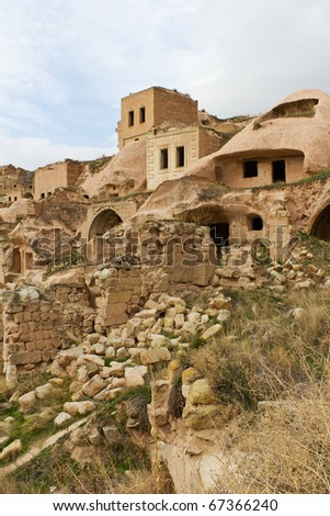 Old Abandoned Rock House Settlement of Cavusin or Chavushin Near Goreme in Cappadocia, Central Turkey - stock photo