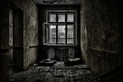 Old abandoned room with a wooden window