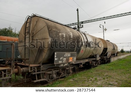 Old, abandoned, rusty oil transporting railway wagons