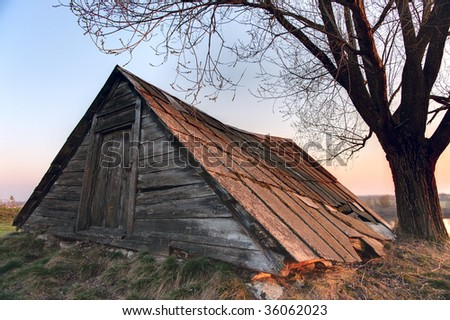 Old abandoned shed in Russian countryside, multiple exposure