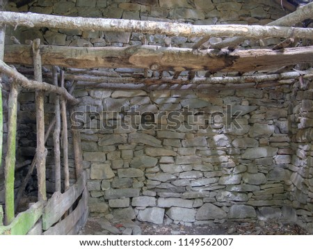 Old abandoned small barn, agricultural building in Italy. Rustic detail background. Animal stalls. #1149562007