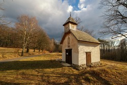 Old abandoned small chapel in the middle of the woods. Wooden church tower, Tribec, Vrch hora, Velky Kliz, Slovakia.