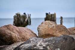Old abandoned stone fishing pier called Bocahenge is L shaped and found in Boca Grande on Gasparilla Island in Florida