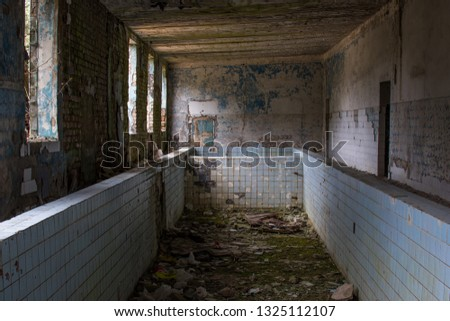Old abandoned swimming pool with dirty water Images and Stock Photos