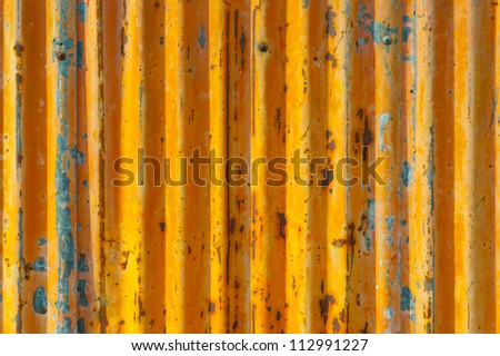 Old abandoned textured orange door