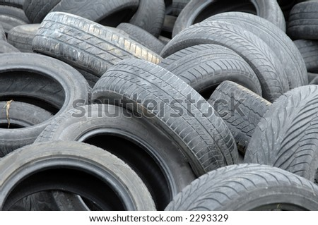 Old abandoned used tires waiting for recycling