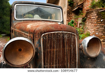 Old abandoned vintage car.