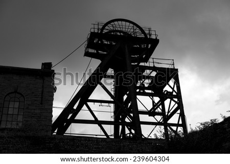 Old abandoned Welsh Coal Mine Pit Gear Silhouette, stormy sky