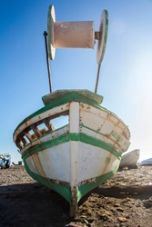 old abandoned wooden boat on the beach, an old shipwreck boat abandoned stand on beach or Shipwrecked off the coast of El Alquian, Almeria, Andalusia, Spain, old rusty wooden boat