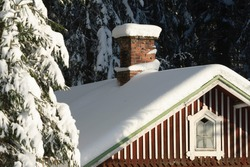 Old abandoned wooden cottage in snowy winter forest