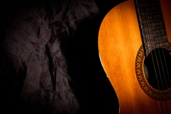 Old acoustic guitar, a classical musical instrument made of primarily wood and metal or nylon strings. Suitable for art backgrounds or illustrations.