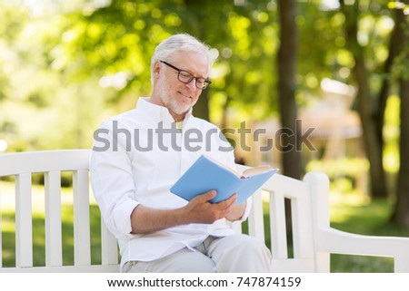 46541d60caba3 Men read a book on a bench in the park Images and Stock Photos ...