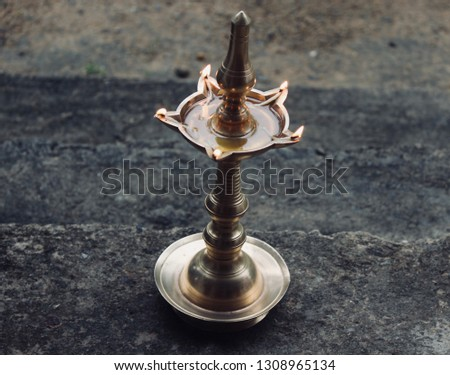 Old Age Tradition of lighting bronze lamp for prosperity and peace #1308965134
